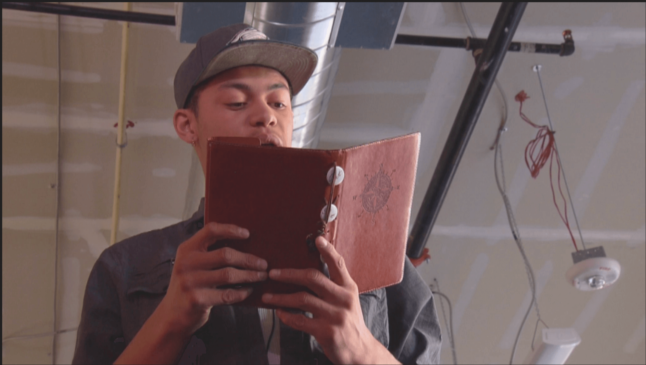 young man reading his poetry