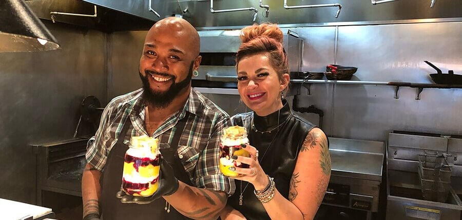 Laura and Chef Brian holding up their blueberry trifles